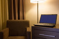 Laptop On Desk In Hotel Room Royalty Free Stock Photo - 27559875