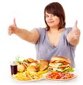 Woman Eating Fast Food. Stock Photography - 27568872