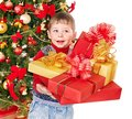 Child With Gift Box Near Christmas Tree. Royalty Free Stock Photos - 27569048