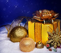 Christmas Ball And Gift Box In Snow. Stock Image - 27569061