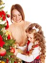 Mother With  Daughter Decorate Christmas Tree. Royalty Free Stock Photo - 27569205
