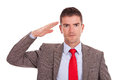 Business Man Gives Salute Royalty Free Stock Photos - 27572868