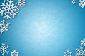 Snowflakes On Icy Background Royalty Free Stock Photo - 27596425