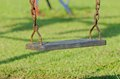 Closeup Of Swings In A Children Play Area Stock Photos - 27598753