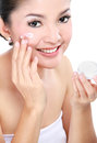 Woman Applying Moisturizer Cream Stock Photography - 27603422
