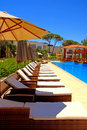 Pool With Pool Bed And Umbrella In Summer Resort Royalty Free Stock Image - 27604796