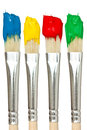 Four Paintbrushes With Color Paints Stock Photos - 27605833