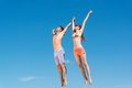 Couple Jumping Together Royalty Free Stock Photos - 27620928