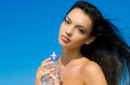 Beautiful Brunette Girl Holding A Bottle Of Water Royalty Free Stock Image - 27627196