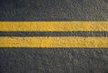 Double Yellow Lines Divider Royalty Free Stock Photos - 27633178