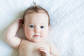 Adorable Blue Eyed Baby On A White Knit Blanket Stock Photography - 27650702