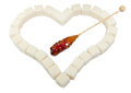Heart From White Sugar Cubes And Candy Sugar Stock Photo - 27662560