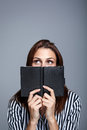 Young Woman Thinking Behind Her Diary Stock Photos - 27664203