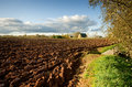 Ploughed Field And House Stock Photography - 27671082