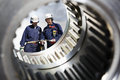 Industry Workers And Gears Shaft Stock Image - 27677081