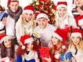 Group People And  Christmas Tree. Royalty Free Stock Photo - 27677695