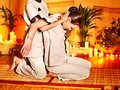 Therapist Giving Stretching Massage To Woman. Royalty Free Stock Photos - 27677778