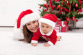 Mother And Baby Girl In Santa Hat Royalty Free Stock Image - 27715096