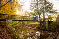 Family Enjoying Autumn Colors On A Park Bridge Stock Images - 27732574