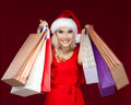 Pretty Girl In Christmas Cap Hands Packets Stock Images - 27746734