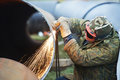 Welder Worker With Flame Torch Cutter Royalty Free Stock Image - 27749186