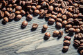 Coffee Seed On Wooden Table Background No. 1 Stock Photo - 27749390