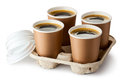 Four Opened Take-out Coffee In Holder Royalty Free Stock Photography - 27767057