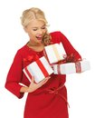 Lovely Woman In Red Dress With Gift Boxes Royalty Free Stock Images - 27783229