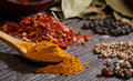 Different Spices Over A Dark Wood. Royalty Free Stock Photo - 27792765