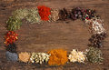 Different Spices Over A Wooden Background. Stock Photos - 27792983