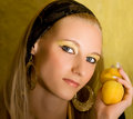 Blond Girl With Apricot Stock Photos - 2786943
