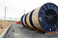 High Voltage Cable Reels And Road Construction Royalty Free Stock Photos - 27806368