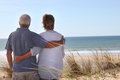 Couple Looking Out To Sea Stock Image - 27806591