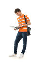 A Young Teenage Boy Holding A Laptop Stock Image - 27816701