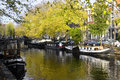 House Boat Along Canal In Amsterdam, Holland Stock Photography - 27823132