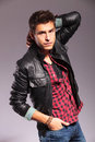 Young Man In Leather Jacket In A Fashion Pose Royalty Free Stock Photo - 27825515