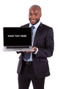 African Business Man Showing A Laptop Screen Stock Image - 27841771