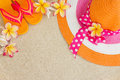 Hat And Flip Flops In The Sand Royalty Free Stock Photo - 27845075