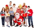Group Of Children With Santa Claus. Stock Photography - 27849702