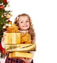 Child With Gift Box Near Christmas Tree. Royalty Free Stock Image - 27849806
