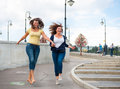 Two Happy Young Beautiful Women Stock Photography - 27861092