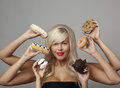 Woman Eating Cream Cakes Stock Images - 27865614