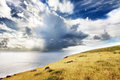 Clouds Over Sea And Green Hill In Easter Island Royalty Free Stock Photo - 27870785