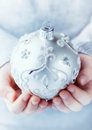 A Child Holding Silver Christmas Ball Stock Photo - 27874150