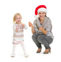 Christmas Portrait Of Mother And Baby Dancing Royalty Free Stock Photos - 27876038