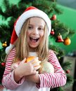 Little Girl In The Santa Claus Hat Stock Photos - 27888393