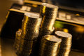 Coins And Gold Bars Stock Photo - 27895210