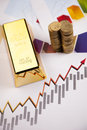 Gold Bars And Money On Charts! Stock Image - 27895251