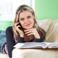 Relaxed Young Woman Talking On Mobile Phone Stock Photos - 27896533