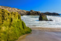 Moss Covered Rocks At Leo Carillo State Beach Stock Photos - 27899413
